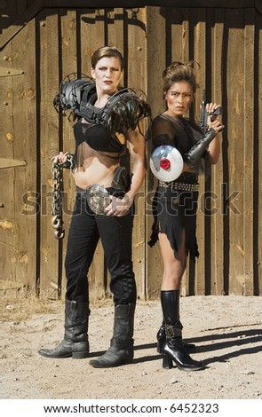 Tough science-fiction women in costumes with weapons.
