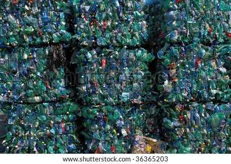 TOULOUSE, FRANCE - CIRCA 2009: Bales of green plastic bottles stacked at an undisclosed recycling facility circa 2009 in Toulouse. The plastic is gathered by color and type to be recycled.