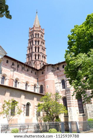 Toulouse, France. Detail of highly detailed bell tower the beautiful Saint Sernin church. It is an ancient medieval church destination of religious pilgrimage on the way to Santiago of Compostela