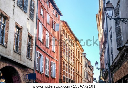 Toulouse has many ancient streets with beautiful colourfull buildings.