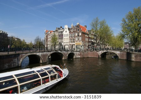 Tour boat in an Amsterdam canal