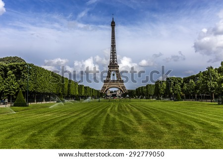 Tour Eiffel (Eiffel Tower) located on Champ de Mars in Paris, named after engineer Gustave Eiffel. Eiffel Tower is tallest structure in Paris and most visited monument in the world. France Stock photo ©