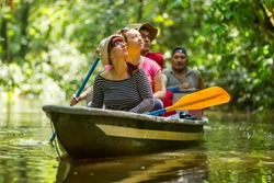 tour tourist boat group jungle travel sightseeing rainforest holiday adventure pioneer boat cruising on misty amazonian water in cuyabeno fauna preserve tour tourist boat group jungle travel sightseei