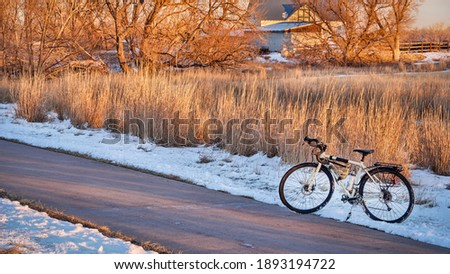touring bicycle in late fall or winter scenery in sunset light on a bike trail in Fort Collins, northern Colorado, recreation and commuting concept Photo stock ©