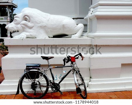 Touring bike in the Bhudda temple,culture city tour,Wat supattnaram ,Ubonratchatani,Thailand #1178944018