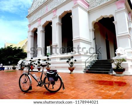 Touring bike in the Bhudda temple,culture city tour,Wat supattnaram ,Ubonratchatani,Thailand #1178944021