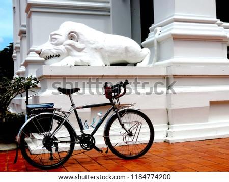 Touring bike in the Bhudda temple,culture city tour,Wat supattnaram ,Ubonratchatani,Thailand #1184774200