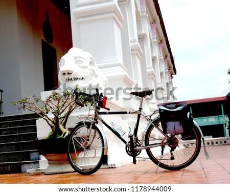 Touring bike in the temple,culture city tour,Wat supattnaram ,Ubonratchatani,Thailand #1178944009