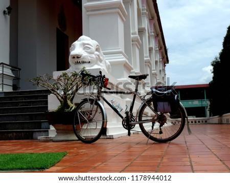 Touring bike in the temple,culture city tour,Wat supattnaram ,Ubonratchatani,Thailand #1178944012