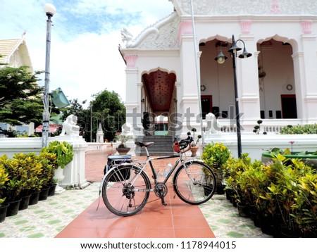 Touring bike in the temple,culture city tour,Wat supattnaram ,Ubonratchatani,Thailand #1178944015