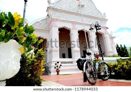 Touring bike in the temple,culture city tour,Wat supattnaram ,Ubonratchatani,Thailand #1178944033