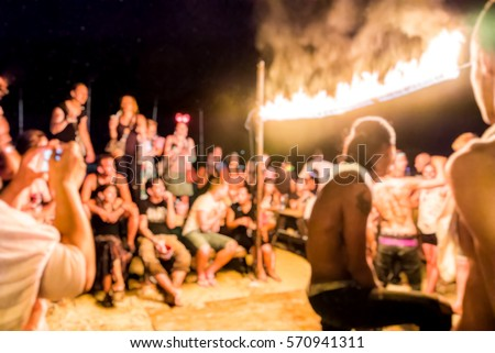 Tourism Hang over at full moon party, Phangan Thailand. People Gathering around the fire, breaker activities game ,  team building
