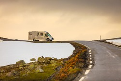 Tourism vacation and travel. Camper van in mountains landscape and mountainroad Aurlandsvegen between Aurland and Lærdal in Norway