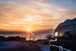 Tourism vacation and travel. Camper van on nature at sunrise over sea surface, Greece Peloponnese Mani Peninsula.