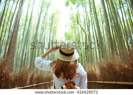 Shutterstock Tourist at Arashiyama bamboo forest in Kyoto, Japan.