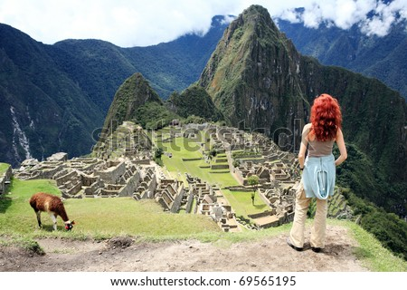 Tourist at Historic Lost City of Machu Picchu - Peru