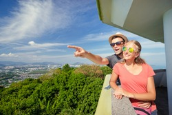 Tourist attraction. Couple of travelers enjoying sea, city and sky on the view point.