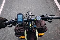 tourist bike steering wheel with backpacks and map in iceland navigator number one highway in summer
