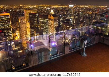 tourist binoculars and new york at night