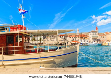 tourist boat anchoring in...