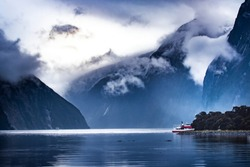 tourist boat cruising in milford sound fjordland national park