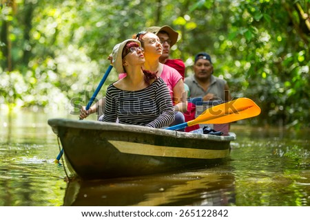Tourist boat navigating on murky Amazonian water in Cuyabeno Wildlife Reserve