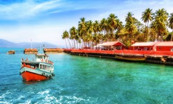 Tourist boat near Ross island beach Andaman India with scenic landscape
