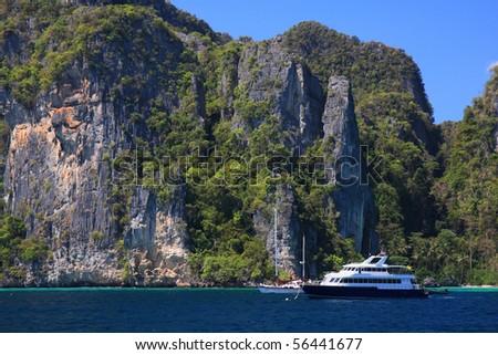 Tourist boat with limestone cliff background, Phi Phi Island, Krabi, Thailand