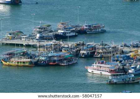 Tourist boats at the Bali Hai pier in Pattaya, Thailand. - stock photo