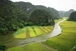 Tourist boats for travelling to sight seeing river 'NgoDong' and rice field at TamCoc,  NinhBinh, VietNam