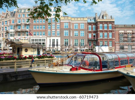 Tourist boats in Amsterdam canal