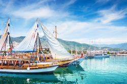 Tourist boats in port of Alanya, Turkey. Beautiful view on the sea and mountains