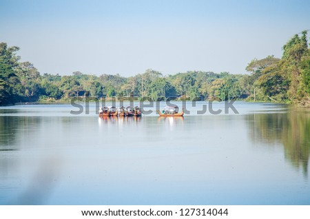 Tourist boats in the moat around Angkor Thom, Angkor, Cambodia