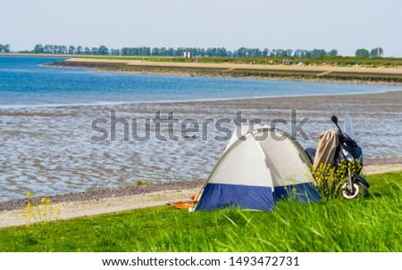 tourist camping in a tent at the beach of tholen, touristic location in zeeland, the netherlands #1493472731