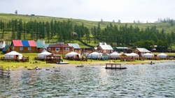 Tourist center in Turt (Khankh) village in Mongolia on the shore of Lake Hovsgol. Yurts - a traditional home in Mongolia.