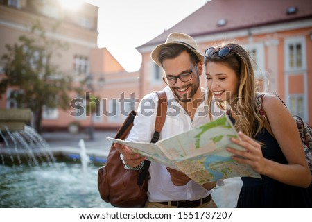 Tourist couple traveling. Travel. Walking on street. Portrait of beautiful young people Stock photo ©