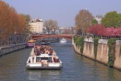 Tourist cruise boat in River Seine Paris France