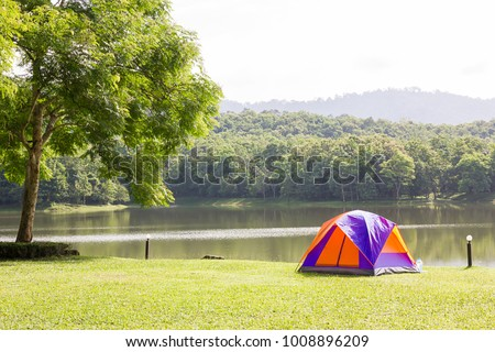 Tourist dome tent camping at lake side  in forest camping site