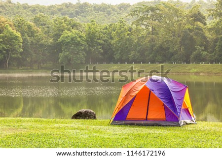 Tourist dome tent camping in forest camping site at lake side #1146172196