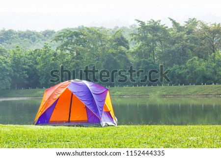 Tourist dome tent camping in forest camping site at lake side #1152444335