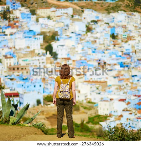 Tourist enjoying aerial view of of Chefchaouen, Morocco, small town in northwest Morocco known for its blue buildings