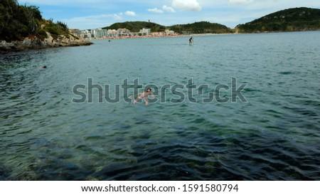 tourist enjoying the calm of the sea