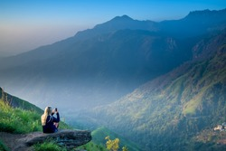 Tourist girl at beautiful landscape in Little Adams's peak, Ella, Srilanka