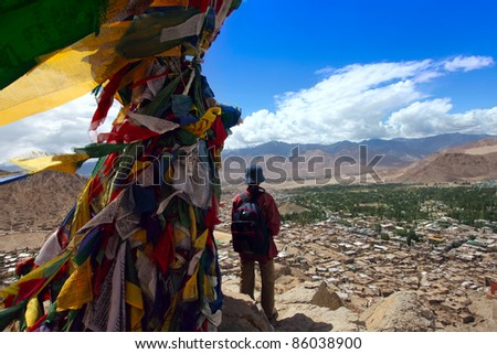 Tourist girl enjoying the views of a mountains landscape. Tourism travel vacation concept.