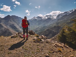 Tourist girl looking at snow covered peaks of High Atlas mountains in Morocco Africa