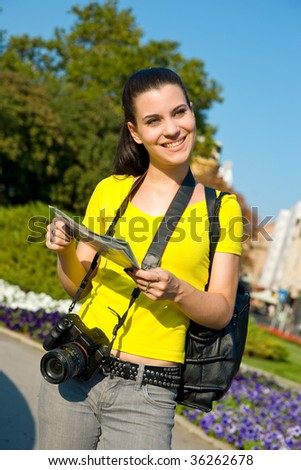 tourist girl student with map and camera