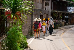 Tourist group walking at Mae Kam pong market in Chiangmai city thailand