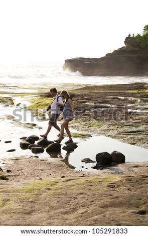 Tourist in Bali at Temple at the Sea -Tanah Lot Temple near Denpasar Town - stock photo