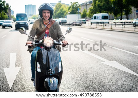 Tourist in Berlin riding scooter in dense traffic #490788553