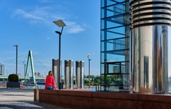 Tourist in Cologne near Kranhaus building complex with crane house on riverside of Rhein in Cologne, Germany.